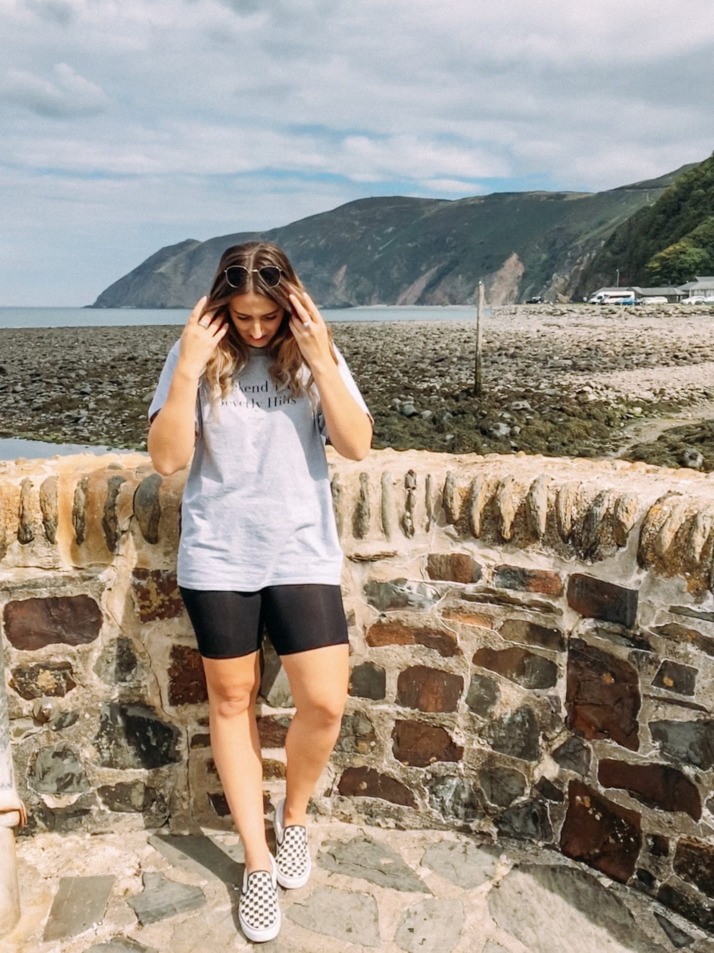 Girl stood on beach at Lynton and Lynmouth