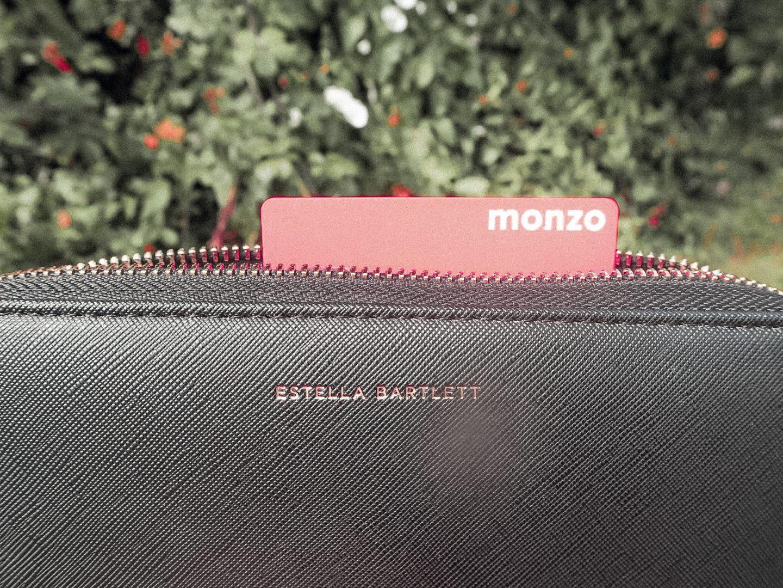 Monzo card in a black purse