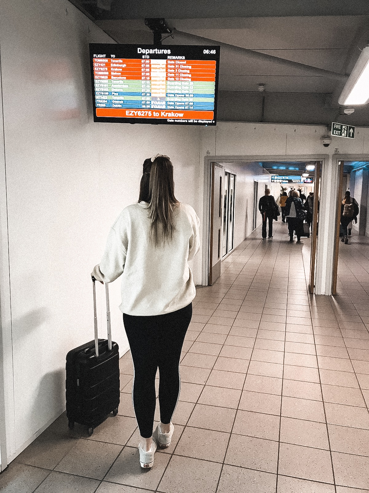 Girl looking at screen in the airport