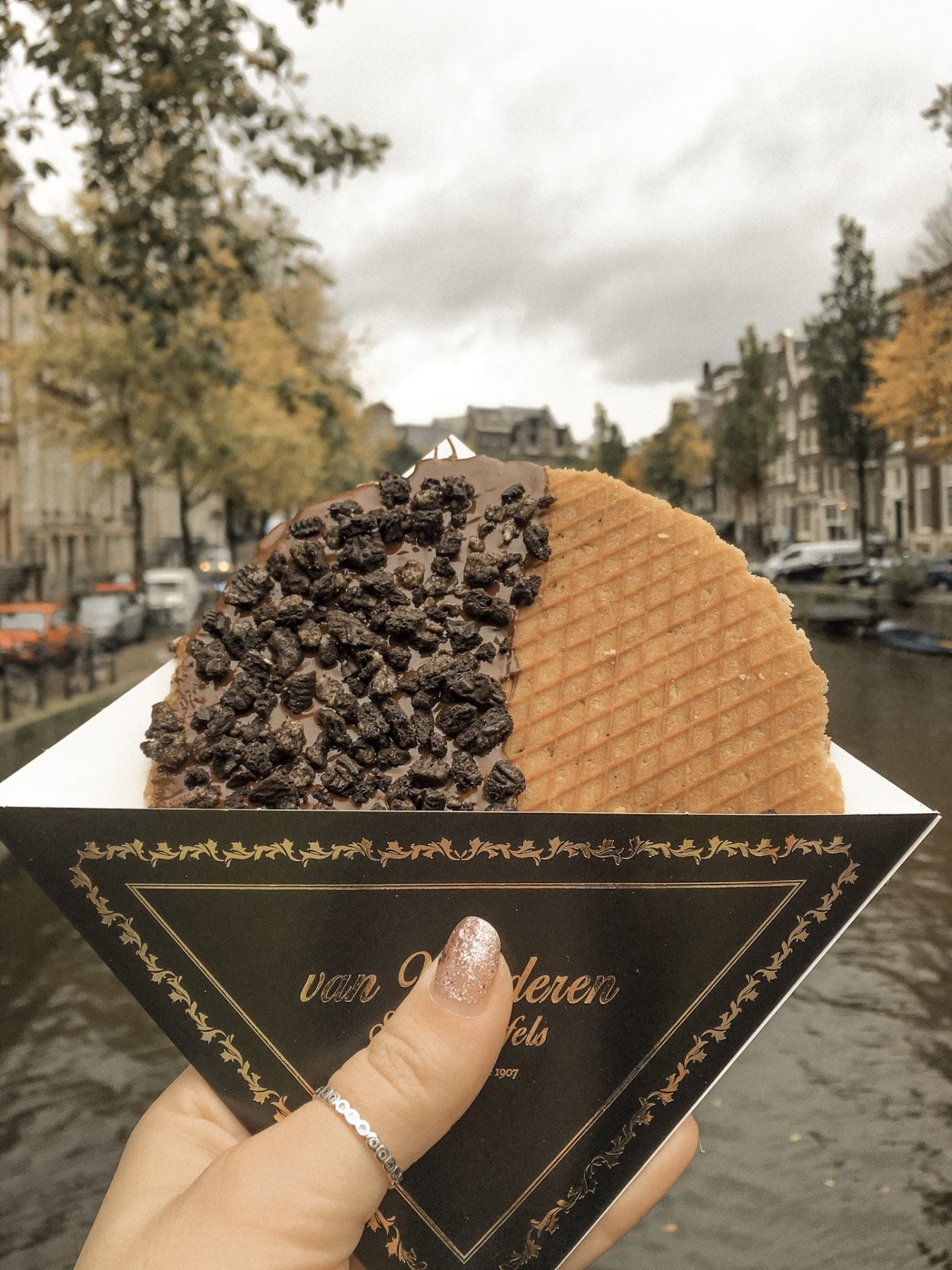 Stroopwafel in Amsterdam by a canal
