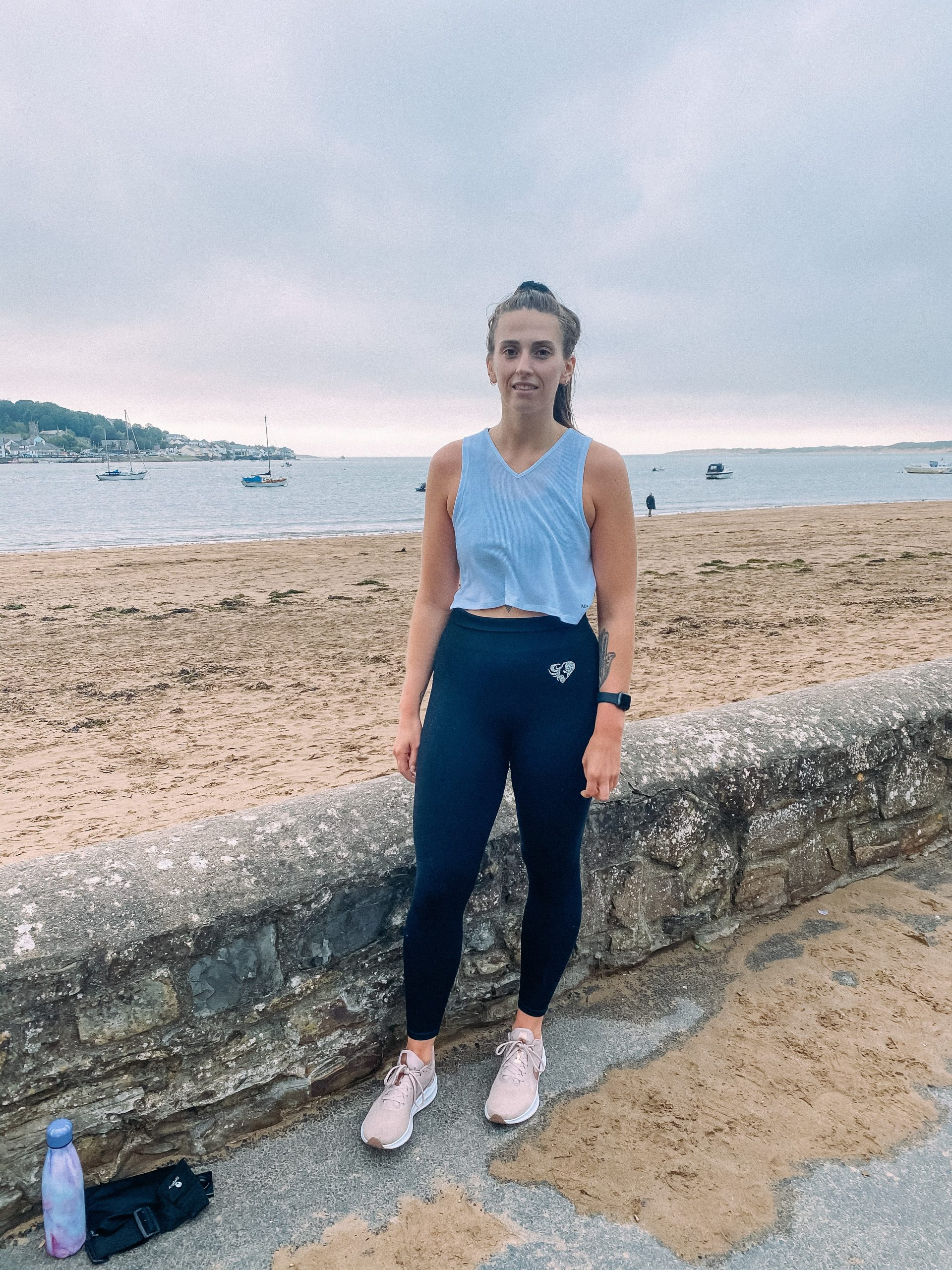 How running has changed my life | girl at Instow beach, devon wearing running clothes